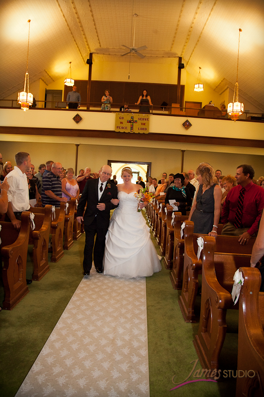 Nikki down the aisle with her dad
