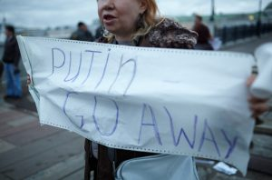MOSCOW-MAY 6: A woman holds a placard with inscription Putin Go Away during a protest rally organized to free prisoners of conscience on May 6 2013 in Moscow, Russia.